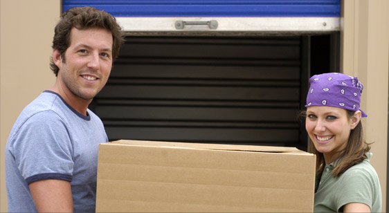 Happy Self-Storage Customers Moving a Box